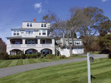 York Harbor house rental - Front of SNI Cottage, showing various verandas, oceanview windows, lawn.