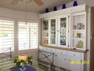 Thousand Palms house photo - Formal dining room with beautiful china cabinet. Lots of light.