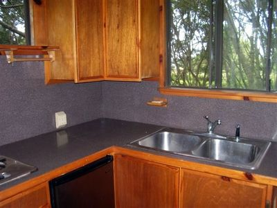 Kitchenette has double burner stove, small refrigerator, toaster and sink