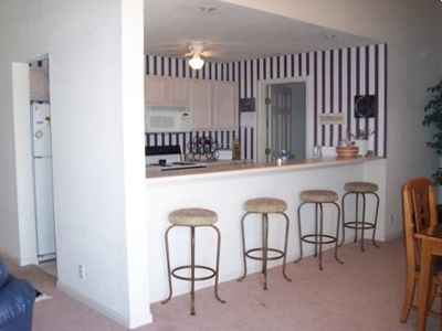kitchen with bar and bar stools