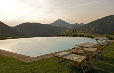 Infinity pool with views on the XI Century Antognolla Castle and Golf