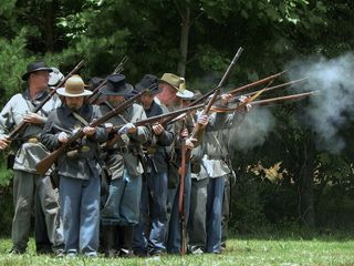 Dillard cabin photo - At Franklin's Annual Folk Festival, Civil War Re-enacters Arrive & Set Up Camp.