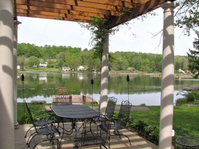 Dinning under the pergola offers great views of the lake.