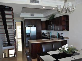 Nassau & Paradise Island townhome photo - View of kitchen, staircase and entrance from the living room.