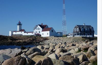 View of the Cottage (right) next to Eastern Point Light House
