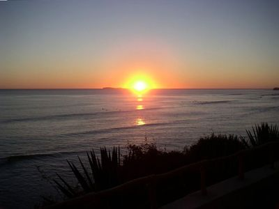 Incredible sunsets from the patio.  Surfers are still in the water.