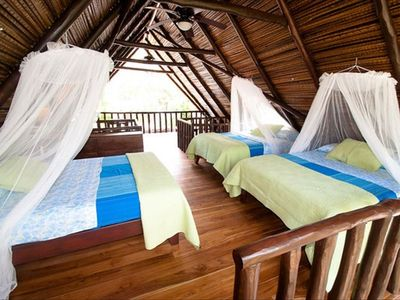 Nosara house rental - Upstairs in the Rancho are three full size beds with mosquito nets.
