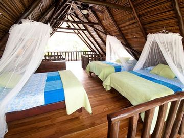 Upstairs in the Rancho are three full size beds with mosquito nets.