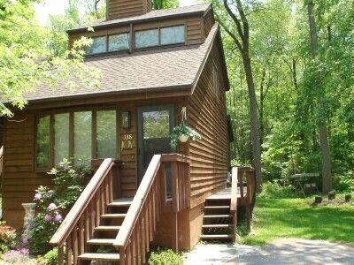 Romantic & elegant Joy Chalet borders 33 acre woodlands yet is right in town!
