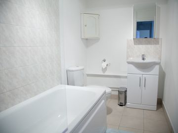 Bathroom with Bath & Shower, Toilet & Sink