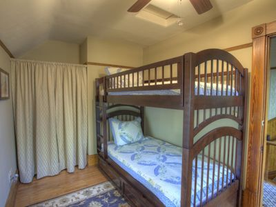 The Lake Huron Room, upstairs with shared bath. Three twin beds (bunk + trundle)