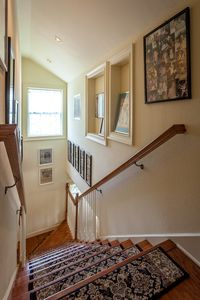 The stairway to the master bedroom.