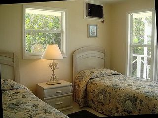 Cayman Brac house photo - upstairs guest beds can convert to a king - big airy windows