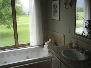Kalispell house photo - One of three main floor bathrooms with Jacuzzi