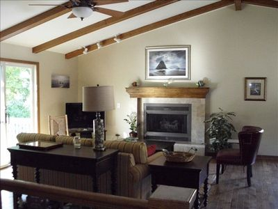 Vaulted-ceiling and fireplace make for lovely family room atmosphere.