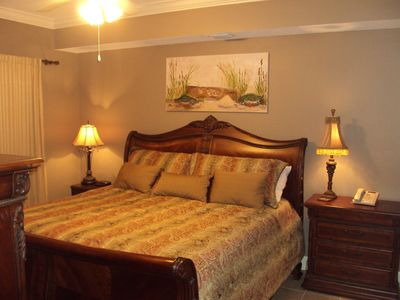The master bedroom suite has a king-size bed!