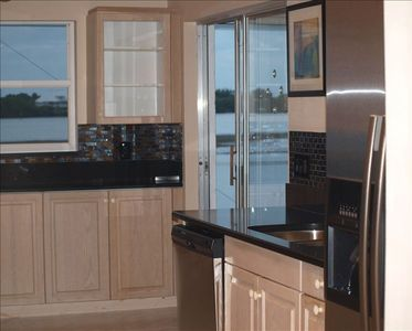 Updated Kitchen with Quartz counters, mosiac glassand stainless appliances