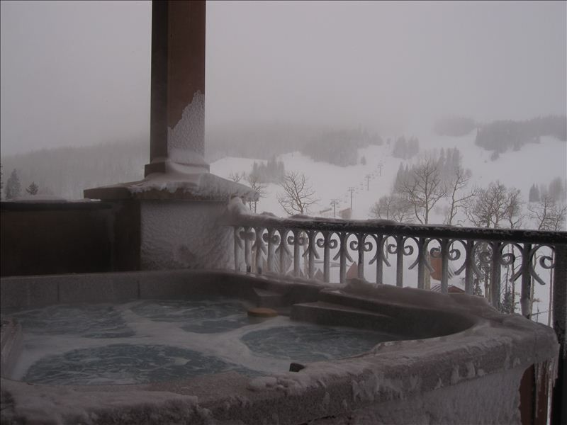Enjoy the view of the slopes from your private spa for Brian head ski resort cabin rental