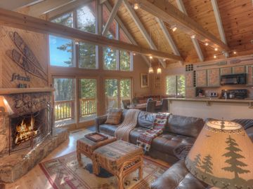 Tahoe City house rental - Open living area with views with floor to ceiling windows that view Twin Peaks.