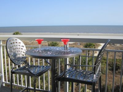 Relax and enjoy the ocean view from our private balcony table or lounge chair