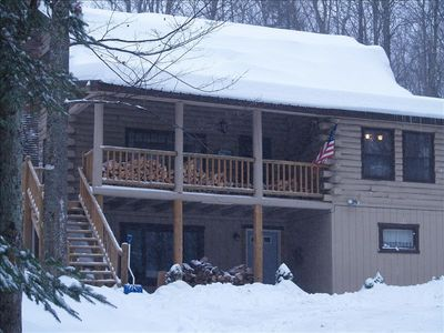 Great picture of house in winter snow; Seasonal in lower apt - great views!!