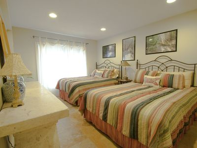 Blue Mountain Beach townhome rental - First Floor Bedroom - Double and Queen beds with original artwork