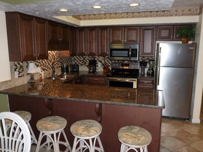 This kitchen seats four at the breakfest bar. All new appliances.