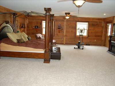 Have sweet dreams in huge master bedroom with cozy fireplace and flat screen TV