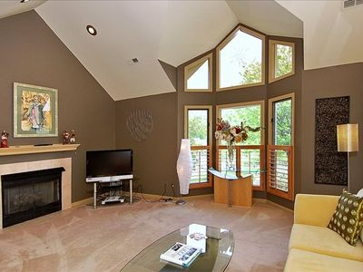 Spacious Living Room Features Gas Log Fireplace & Cathedral Ceiling.