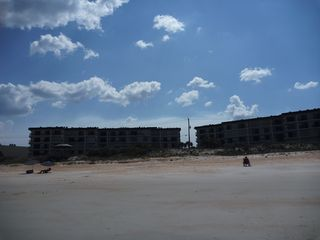 Ormond-by-the-Sea condo photo - View of both buildings from the beach during low tide