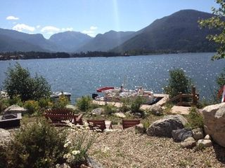 Grand Lake house photo - Overlooking picnic/lounge area to boat dock. Mt. Baldy in the background.