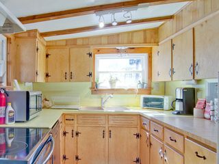 Elkton cabin photo - Fully outfitted kitchen with cookware, dishes and place settings provided.