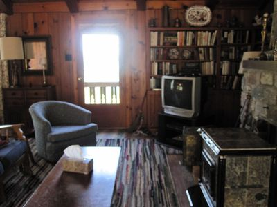 TV area near Franklin stove in main living room.