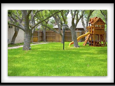 Big back yard with playground scape