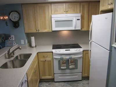 Glass top stove, microwave , refrigertor with icemaker