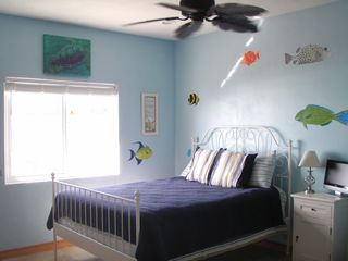 Aquarium Bedroom has a Queen bed and faces the sea. - Cat Island house vacation rental photo