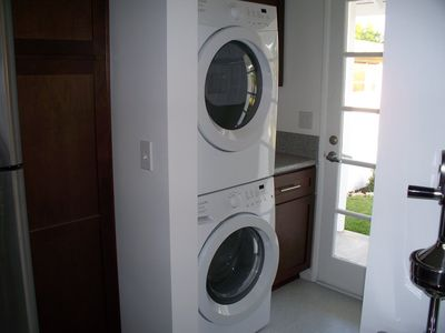 Laundry area with large capacity front loading washer and dryer