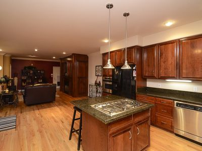 Kitchen is wide open into family room with outdoor spa and patio area to left OD