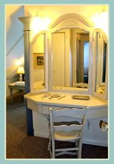 Courtenay house photo - Vanity in Upstairs King Bedroom