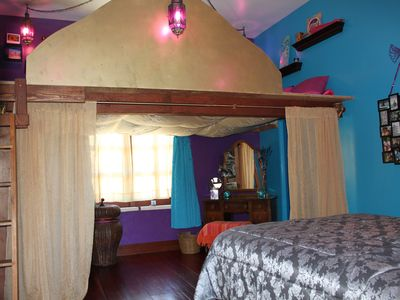 You are royalty in this exotic room. Queen loft waterbed and standard queen bed.