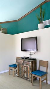 TV with programing, additional dining chairs, cabinet with games/movies