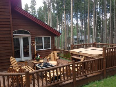 family room deck with hot tub and fire pit area.  View of mountains from hot tub