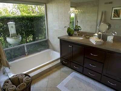 Luxurious Master bath with soaking tub and garden views