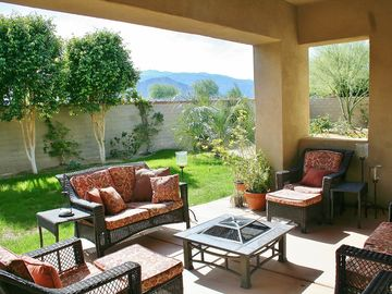 Patio off Great Room w/Gas BBQ, firepit, dining table,chaises & incredible views