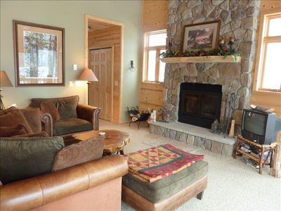 Comfy second living area with wood burning fireplace and views onto the lake!