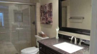 Anaheim house rental - Ensuite natural limestone Master Bath with marble floors