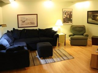 Lamoine apartment photo - The lounge has a couch, recliner and flat screen TV