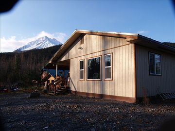 Seward house rental - Creek side of house. Windows look out at bon fire area and glacier creek.