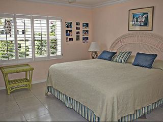 Grand Cayman condo photo - Master Bedroom has privacy, en suite bathroom and views!