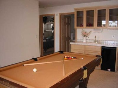 Game Room with wet bar and refrigerator
